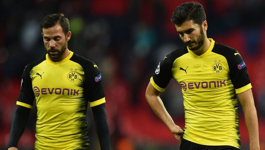 (L-R) Borussia Dortmund's German midfielder Gonzalo Castro and Borussia Dortmund's Turkish midfielder Nuri Sahin react after losing the UEFA Champions League Group H football match between Tottenham Hotspur and Borussia Dortmund at Wembley Stadium in London, on September 13, 2017. / AFP PHOTO / Glyn KIRK        (Photo credit should read GLYN KIRK/AFP/Getty Images)