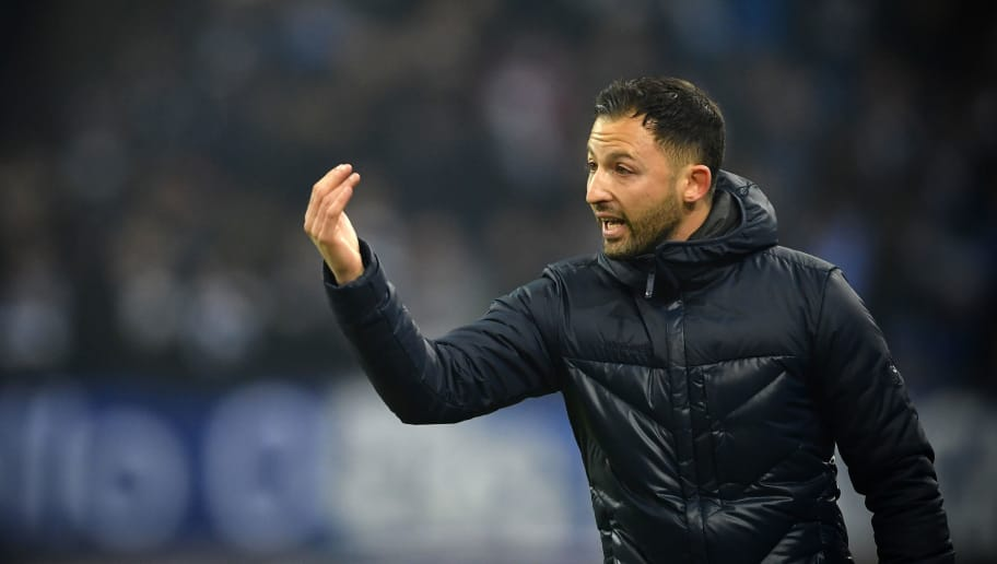 GELSENKIRCHEN, GERMANY - FEBRUARY 07:   (EDITORS NOTE; This image was processed using digital filters.)Domenico Tedesco, head coach of Schalke reacts during the DFB Pokal quarter final match between FC Schalke 04 and VfL Wolfsburg at Veltins-Arena on February 7, 2018 in Gelsenkirchen, Germany.  (Photo by Stuart Franklin/Bongarts/Getty Images)