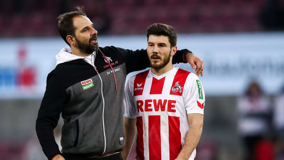 COLOGNE, GERMANY - JANUARY 27: Stefan Ruthenbeck Head Coach of 1. FC Koeln and Milos Jojic #8 of 1.FC Koeln react after the Bundesliga match between 1. FC Koeln and FC Augsburg at RheinEnergieStadion on January 27, 2018 in Cologne, Germany. (Photo by Maja Hitij/Bongarts/Getty Images)