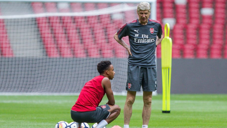 BEIJING, CHINA - JULY 21:  Arsene Wenger talks with Danny Welbeck During a training session at Birds Nest on July 21, 2017 in Beijing, China.  (Photo by Yifan Ding/Getty Images)