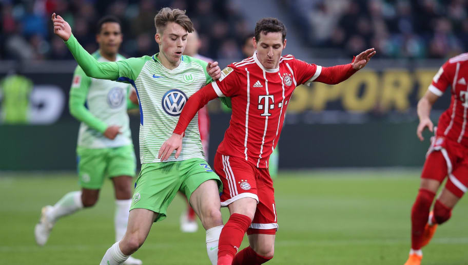 Wolfsburg's German defender Gian-Luca Itter (L) and Bayern Munich's German midfielder Sebastian Rudy (R) compete during the German first division Bundesliga football match VfL Wolfsburg vs FC Bayern Munich at Volkswagen Arena on February 17, 2018 in Wolfsburg, Germany. / AFP PHOTO / Ronny Hartmann / RESTRICTIONS: DURING MATCH TIME: DFL RULES TO LIMIT THE ONLINE USAGE TO 15 PICTURES PER MATCH AND FORBID IMAGE SEQUENCES TO SIMULATE VIDEO. == RESTRICTED TO EDITORIAL USE == FOR FURTHER QUERIES PLEASE CONTACT DFL DIRECTLY AT + 49 69 650050         (Photo credit should read RONNY HARTMANN/AFP/Getty Images)