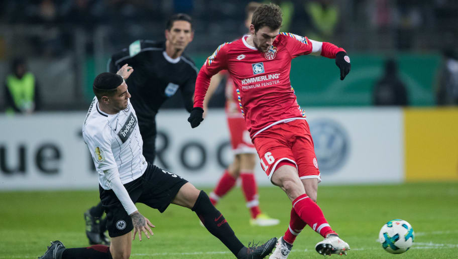 FRANKFURT AM MAIN, GERMANY - FEBRUARY 07: Stefan Bell of Mainz is challenged by Omar Mascarell of Frankfurt during the DFB Cup quarter final match between Eintracht Frankfurt and 1. FSV Mainz 05 at Commerzbank-Arena on February 7, 2018 in Frankfurt am Main, Germany. (Photo by Simon Hofmann/Bongarts/Getty Images)