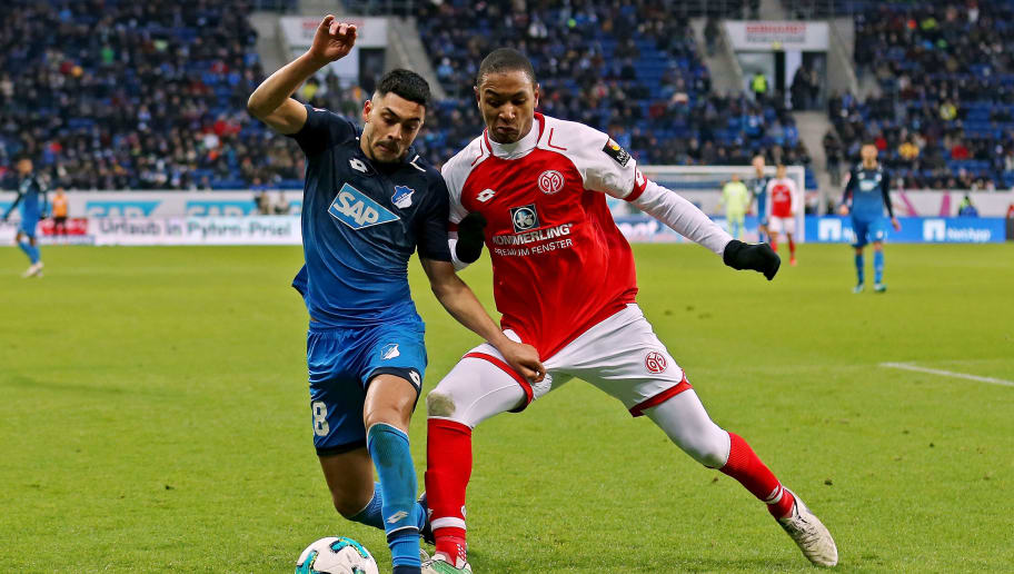 SINSHEIM, GERMANY - FEBRUARY 10:  Nadiem Amiri (L) of Hoffenheim fights for the ball with Abdou-Lakhad Diallo (R) of Mainz during the Bundesliga match between TSG 1899 Hoffenheim and 1. FSV Mainz 05 at Wirsol Rhein-Neckar-Arena on February 10, 2018 in Sinsheim, Germany.  (Photo by Thomas Niedermueller/Bongarts/Getty Images)
