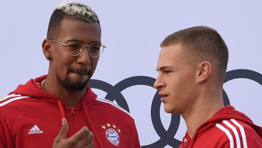 (L-R) Bayern Munich's defender Niklas Suele, Bayern Munich's defender Jerome Boateng and Bayern Munich's midfielder Joshua Kimmich are pictured during a car handover event at the Audi headquarters in Ingolstadt, southern Germany, on October 11, 2017.  / AFP PHOTO / Christof STACHE        (Photo credit should read CHRISTOF STACHE/AFP/Getty Images)