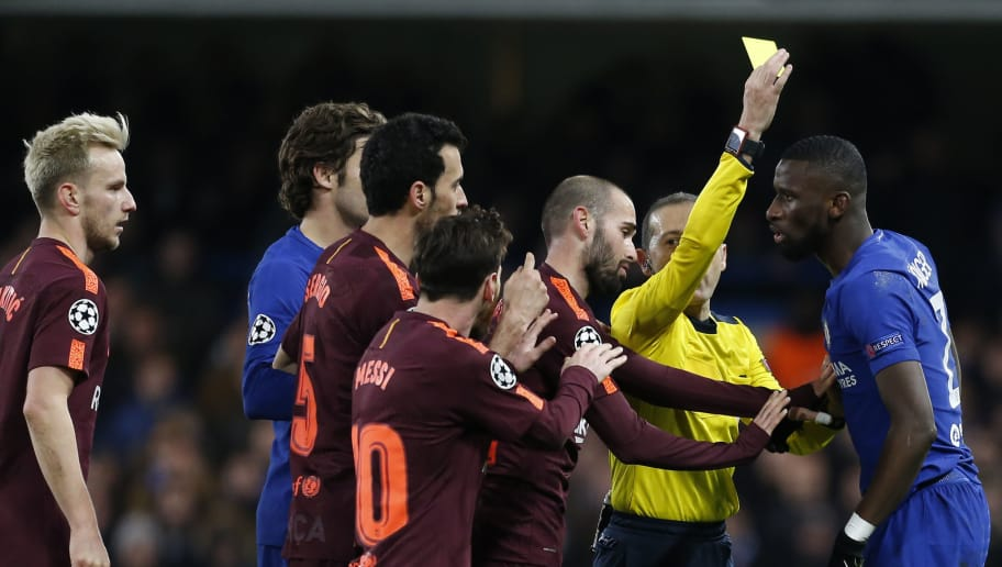 Chelsea's German defender Antonio Rudiger (R) gets a yellow card during the first leg of the UEFA Champions League round of 16 football match between Chelsea and Barcelona at Stamford Bridge stadium in London on February 20, 2018. / AFP PHOTO / IKIMAGES / Ian KINGTON        (Photo credit should read IAN KINGTON/AFP/Getty Images)