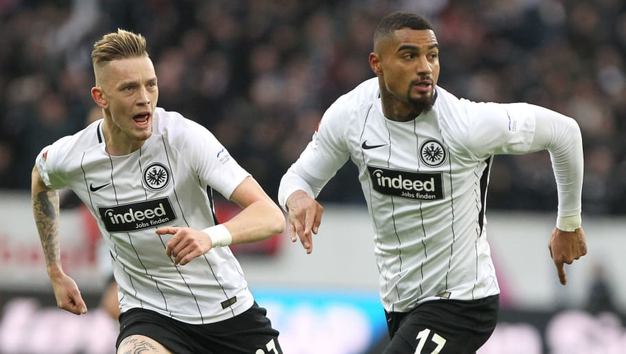 Frankfurt's Ghanaian midfielder Kevin-Prince Boateng (R) celebrates scoring the 1-0 next to Frankfurt's German midfielder Marius Wolf during the German First division Bundesliga football match TSG 1899 Hoffenheim vs Eintracht Frankfurt in Sinsheim, southwest Germany, on November 18, 2017. / AFP PHOTO / Amelie QUERFURTH / RESTRICTIONS: DURING MATCH TIME: DFL RULES TO LIMIT THE ONLINE USAGE TO 15 PICTURES PER MATCH AND FORBID IMAGE SEQUENCES TO SIMULATE VIDEO. == RESTRICTED TO EDITORIAL USE == FOR FURTHER QUERIES PLEASE CONTACT DFL DIRECTLY AT + 49 69 650050         (Photo credit should read AMELIE QUERFURTH/AFP/Getty Images)