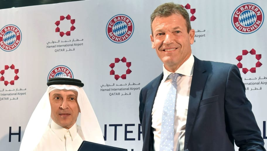 ?FC Bayern Munich's Executive Board Member, Andreas Jung, (R) shakes hands with the General Chief Executive (GCE) of Qatar Airways Akbar al-Baker during a press conference at the Hamad International Airport in Doha to announce a new sponsorship deal between the club and the airport on August 14, 2017.  / AFP PHOTO / STRINGER        (Photo credit should read STRINGER/AFP/Getty Images)