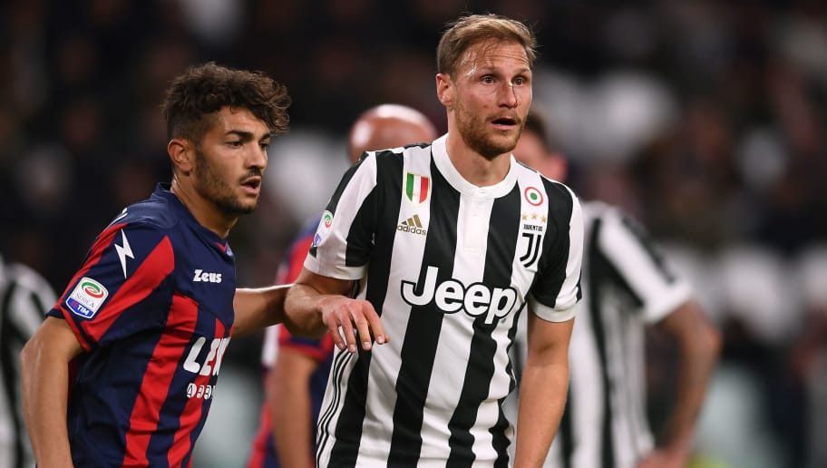 Juventus's defender Benedikt Howedes from Germany (R) looks on during the Italian Serie A football match Juventus Vs Crotone on November 26, 2017 at the 'Allianz Stadium' in Turin.  / AFP PHOTO / MARCO BERTORELLO        (Photo credit should read MARCO BERTORELLO/AFP/Getty Images)