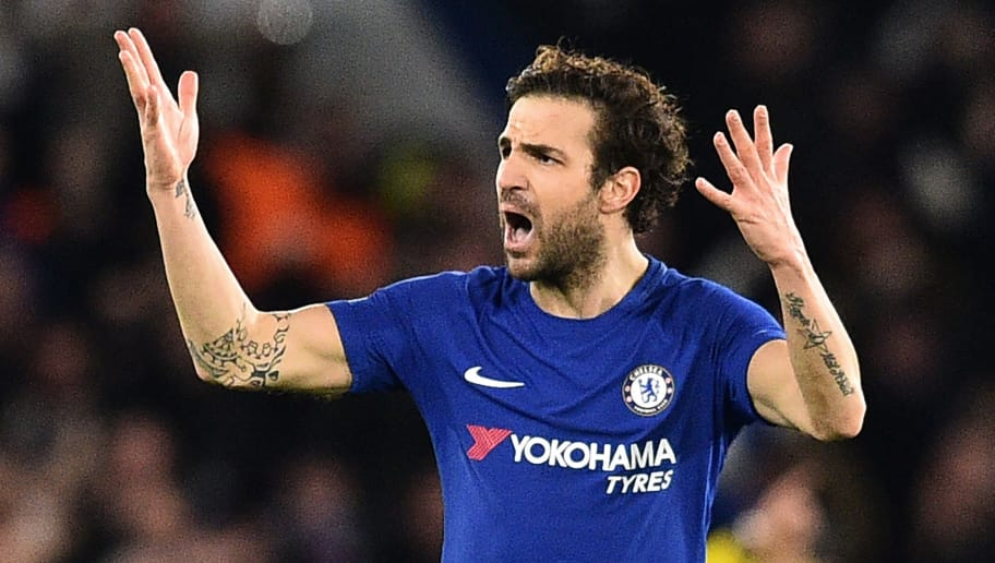 Chelsea's Spanish midfielder Cesc Fabregas gestures to the crowd after Chelsea take the lead during the first leg of the UEFA Champions League round of 16 football match between Chelsea and Barcelona at Stamford Bridge stadium in London on February 20, 2018. / AFP PHOTO / Glyn KIRK        (Photo credit should read GLYN KIRK/AFP/Getty Images)