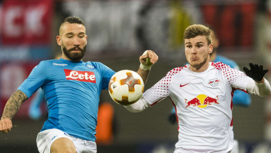 Leipzig's forward Timo Werner (R) and Napoli's Italian Portuguese defender Mario Rui vie for the ball  during the UEFA Europa League football match between SSC Napoli and RB Leipzig, on February 22, 2018 in Leipzig.  / AFP PHOTO / ROBERT MICHAEL        (Photo credit should read ROBERT MICHAEL/AFP/Getty Images)