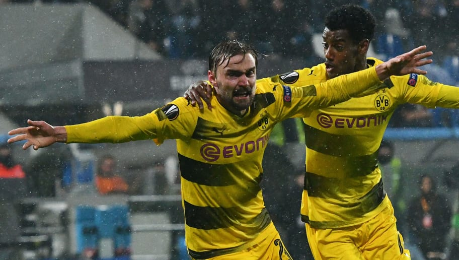 Borussia Dortmund's defender from Germany Marcel Schmelzer (L) celebrates after scoring during the round of 32 second leg UEFA Europa League football match between Atalanta and Borussia Dortmund at The Mapei Stadium in Reggio Emilia on February 22, 2018. / AFP PHOTO / Vincenzo PINTO        (Photo credit should read VINCENZO PINTO/AFP/Getty Images)