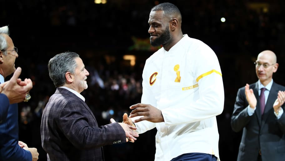 CLEVELAND, OH - OCTOBER 25: LeBron James #23 of the Cleveland Cavaliers recieves his championship ring from owner Dan Gilbert before the game against the New York Knicks at Quicken Loans Arena on October 25, 2016 in Cleveland, Ohio.   NOTE TO USER: User expressly acknowledges and agrees that, by downloading and or using this photograph, User is consenting to the terms and conditions of the Getty Images License Agreement. (Photo by Ezra Shaw/Getty Images)
