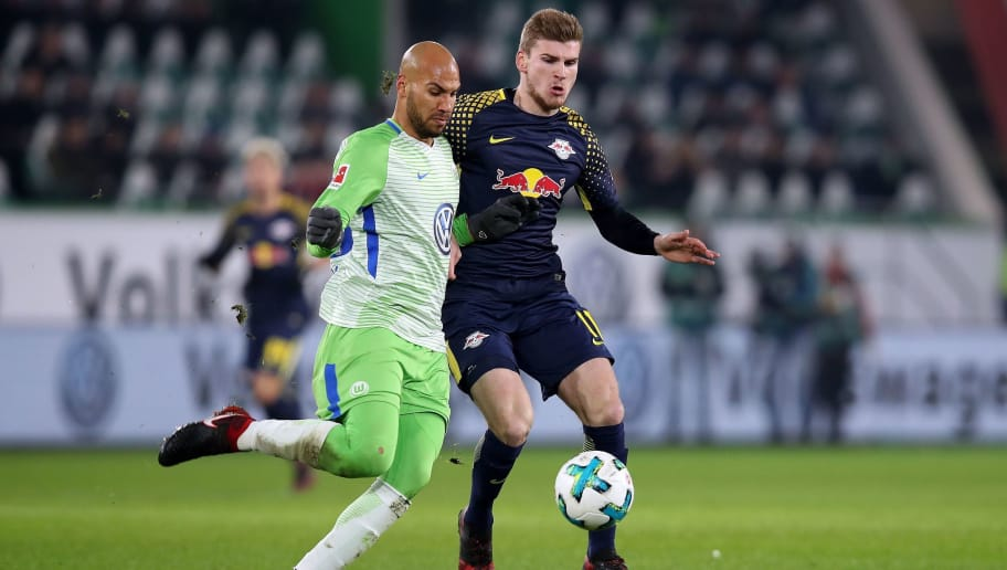 Leipzig's forward Timo Werner (R) and Wolfsburg's US defender John Anthony Brooks (L)  during the German first division Bundesliga football match between VfL Wolfsburg and RB Leipzig on December 12, 2017 in Wolfsburg.  / AFP PHOTO / Ronny Hartmann / RESTRICTIONS: DURING MATCH TIME: DFL RULES TO LIMIT THE ONLINE USAGE TO 15 PICTURES PER MATCH AND FORBID IMAGE SEQUENCES TO SIMULATE VIDEO. == RESTRICTED TO EDITORIAL USE == FOR FURTHER QUERIES PLEASE CONTACT DFL DIRECTLY AT + 49 69 650050         (Photo credit should read RONNY HARTMANN/AFP/Getty Images)