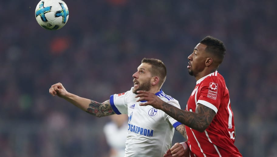 MUNICH, GERMANY - FEBRUARY 10: Guido Burgstaller of Schalke is challenged by Jerome Boateng of Muenchen during the Bundesliga match between FC Bayern Muenchen and FC Schalke 04 at Allianz Arena on February 10, 2018 in Munich, Germany.  (Photo by Alex Grimm/Bongarts/Getty Images)