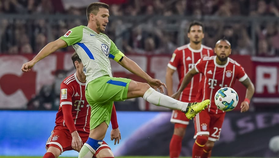 Wolfsburg's Spanish midfielder Ignacio Camacho shoots the ball during the German First division Bundesliga football match FC Bayern Munich vs VfL Wolfsburg in Munich, southern Germany, on September 22, 2017. / AFP PHOTO / Guenter SCHIFFMANN / RESTRICTIONS: DURING MATCH TIME: DFL RULES TO LIMIT THE ONLINE USAGE TO 15 PICTURES PER MATCH AND FORBID IMAGE SEQUENCES TO SIMULATE VIDEO. == RESTRICTED TO EDITORIAL USE == FOR FURTHER QUERIES PLEASE CONTACT DFL DIRECTLY AT + 49 69 650050         (Photo credit should read GUENTER SCHIFFMANN/AFP/Getty Images)