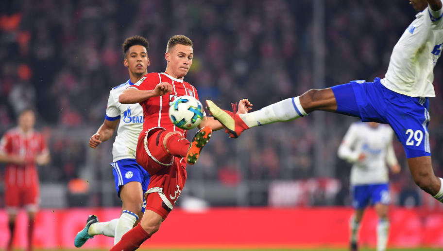 MUNICH, GERMANY - FEBRUARY 10: Joshua Kimmich of Bayern Muenchen (c) is challenged by Naldo of Schalke (r) and followed by Thilo Kehrer of Schalke during the Bundesliga match between FC Bayern Muenchen and FC Schalke 04 at Allianz Arena on February 10, 2018 in Munich, Germany. (Photo by Sebastian Widmann/Bongarts/Getty Images)
