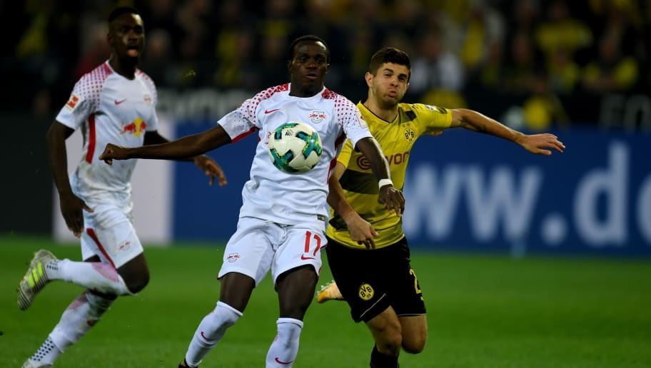 Dortmund's US midfielder Christian Pulisic and Leipzig's Guinean midfielder Naby Keita (L) vie for the ball during the German first division Bundesliga football match Borussia Dortmund vs RB Leipzig in Dortmund, western Germany, on October 14, 2017. / AFP PHOTO / PATRIK STOLLARZ / RESTRICTIONS: DURING MATCH TIME: DFL RULES TO LIMIT THE ONLINE USAGE TO 15 PICTURES PER MATCH AND FORBID IMAGE SEQUENCES TO SIMULATE VIDEO. == RESTRICTED TO EDITORIAL USE == FOR FURTHER QUERIES PLEASE CONTACT DFL DIRECTLY AT + 49 69 650050         (Photo credit should read PATRIK STOLLARZ/AFP/Getty Images)