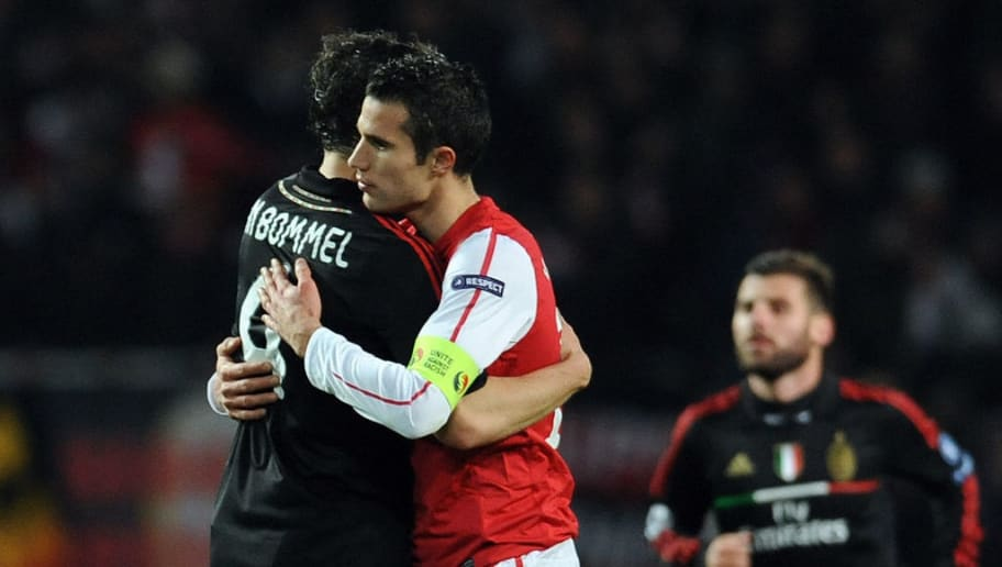 AC Milan's Dutch midfielder Mark Van Bommeli (L) hugs Arsenal's Dutch striker Robin Van Persie after the final whistle of an UEFA Champions League round of 16 second leg football match at the Emirates Stadium, North London, England on March 6, 2012. AFP PHOTO/ADRIAN DENNIS (Photo credit should read ADRIAN DENNIS/AFP/Getty Images)