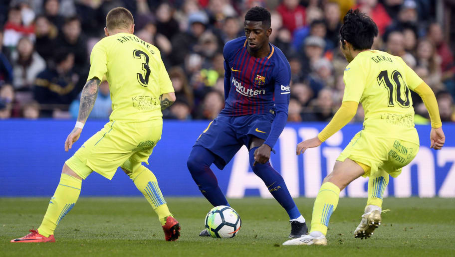 Barcelona's French forward Ousmane Dembele (C) vies with Getafe's Portuguese defender Vitorino Antunes (L) and Getafe's Japanese midfielder Gaku Shibasaki during the Spanish league football match between FC Barcelona and Getafe CF at the Camp Nou stadium in Barcelona on February 11, 2018. / AFP PHOTO / Josep LAGO        (Photo credit should read JOSEP LAGO/AFP/Getty Images)