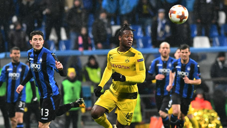 Atalanta's defender from Italy Mattia Caldara (L) fights for the ball with  Borussia Dortmund's forward from Belgium Michy Batshuayi during the round of 32 second leg UEFA Europa League football match between Atalanta and Borussia Dortmund at The Mapei Stadium in Reggio Emilia on February 22, 2018. / AFP PHOTO / Vincenzo PINTO        (Photo credit should read VINCENZO PINTO/AFP/Getty Images)