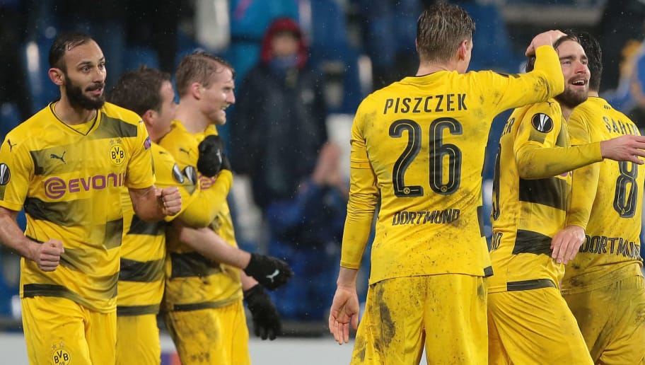 REGGIO NELL'EMILIA, ITALY - FEBRUARY 22:  Marcel Schmelzer (2nd R) of Borussia Dortmund celebrates with his team-mates the victory at the end of the UEFA Europa League Round of 32 match between Atalanta and Borussia Dortmund at the Mapei Stadium - Citta' del Tricolore on February 22, 2018 in Reggio nell'Emilia, Italy.  (Photo by Emilio Andreoli/Getty Images)