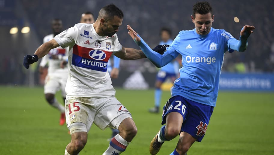 Marseille's French forward Florian Thauvin (R) fights for the ball with Lyon's French defender Jeremy Morel (L) during the French L1 football match Olympique Lyonnais (OL) vs Marseille (OM) at the Parc Olympique Lyonnais stadium in Decines-Charpieu, central-eastern France on December 17, 2017. / AFP PHOTO / ROMAIN LAFABREGUE        (Photo credit should read ROMAIN LAFABREGUE/AFP/Getty Images)