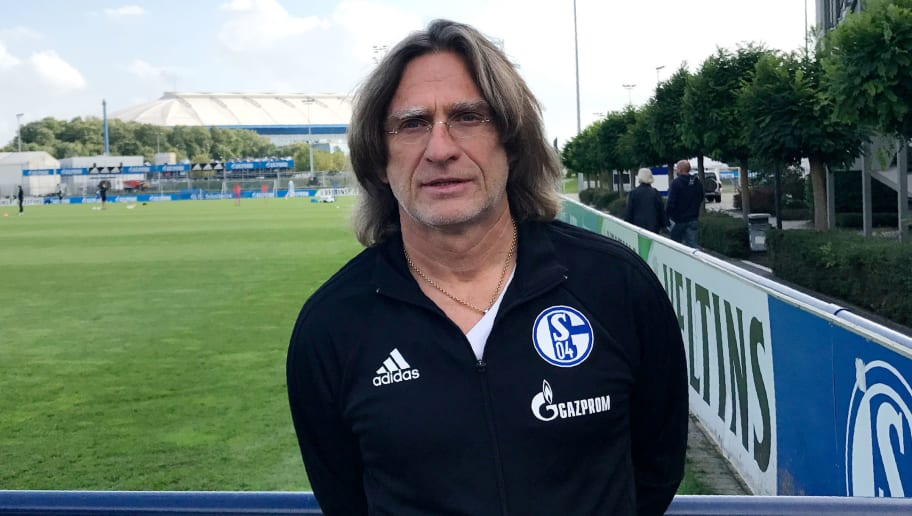 German coach Norbert Elgert, in charge of the Under-19 team at the Schalke's youth academy, poses at the footbal club's training grounds on October 2, 2017 in Gelsenkirchen. Schalke 04 are a sleeping giant in the German league, yet their youth academy is one of Germany's most successful, producing World Cup winners, Bundesliga stars and Premier League exports. / AFP PHOTO / Ryland JAMES        (Photo credit should read RYLAND JAMES/AFP/Getty Images)