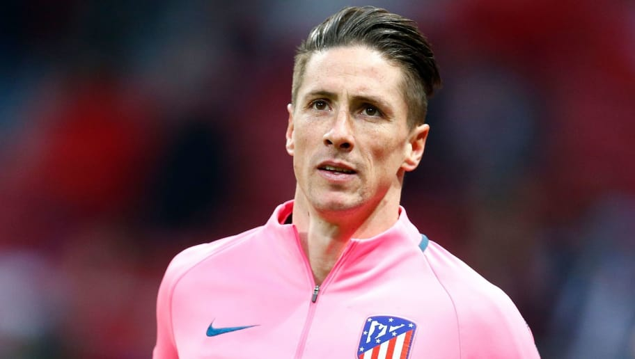 Atletico Madrid's Spanish forward Fernando Torres warms up before the Europa League Round of 32 second leg football match between Club Atletico de Madrid and FC Copenhagen at the Wanda Metropolitano stadium in Madrid on February 22, 2018. / AFP PHOTO / Benjamin CREMEL        (Photo credit should read BENJAMIN CREMEL/AFP/Getty Images)