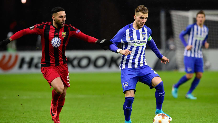 Berlin's Slovakian defender Peter Pekarik (R) and Ostersund's Saman Ghoddos vie for the ball during the UEFA Europa League group J football match Hertha BSC Berlin vs Ostersund FK on December 7, 2017 in Berlin.  / AFP PHOTO / Tobias SCHWARZ        (Photo credit should read TOBIAS SCHWARZ/AFP/Getty Images)