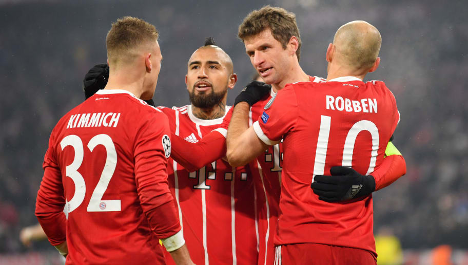 MUNICH, GERMANY - FEBRUARY 20: Thomas Mueller of Bayern Muenchen celebrates with teammates Joshua Kimmich, Arturo Vidal and Arjen Robben after scoring his teams third goal during the UEFA Champions League Round of 16 First Leg match between Bayern Muenchen and Besiktas at Allianz Arena on February 20, 2018 in Munich, Germany. (Photo by Sebastian Widmann/Bongarts/Getty Images)