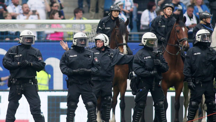 HAMBURG, GERMANY - MAY 20: Police with horses is seen on the pitch after the Bundesliga match between Hamburger SV and VfL Wolfsburg at Volksparkstadion on May 20, 2017 in Hamburg, Germany. (Photo by Selim Sudheimer/Bongarts/Getty Images)