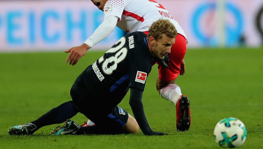 LEIPZIG, GERMANY - DECEMBER 17:  Yussuf Poulsen of RB Leipzig battles for the ball with Fabian Lustenberger of Hertha BSC during the Bundesliga match between RB Leipzig and Hertha BSC at Red Bull Arena on December 17, 2017 in Leipzig, Germany.  (Photo by Boris Streubel/Bongarts/Getty Images)