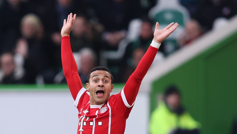 Bayern Munich's Spanish midfielder Thiago Alcantara reacts during the German first division Bundesliga football match VfL Wolfsburg vs FC Bayern Munich at Volkswagen Arena on February 17, 2018 in Wolfsburg, Germany. / AFP PHOTO / Ronny Hartmann / RESTRICTIONS: DURING MATCH TIME: DFL RULES TO LIMIT THE ONLINE USAGE TO 15 PICTURES PER MATCH AND FORBID IMAGE SEQUENCES TO SIMULATE VIDEO. == RESTRICTED TO EDITORIAL USE == FOR FURTHER QUERIES PLEASE CONTACT DFL DIRECTLY AT + 49 69 650050         (Photo credit should read RONNY HARTMANN/AFP/Getty Images)