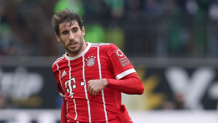 Bayern Munich's Spanish midfielder Javi Martinez passes the ball during the German first division Bundesliga football match VfL Wolfsburg vs FC Bayern Munich at Volkswagen Arena on February 17, 2018 in Wolfsburg, Germany. / AFP PHOTO / Ronny Hartmann / RESTRICTIONS: DURING MATCH TIME: DFL RULES TO LIMIT THE ONLINE USAGE TO 15 PICTURES PER MATCH AND FORBID IMAGE SEQUENCES TO SIMULATE VIDEO. == RESTRICTED TO EDITORIAL USE == FOR FURTHER QUERIES PLEASE CONTACT DFL DIRECTLY AT + 49 69 650050         (Photo credit should read RONNY HARTMANN/AFP/Getty Images)