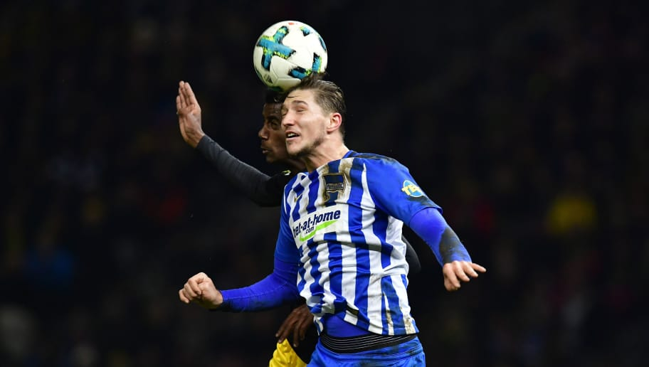 Berlin's Czech midfielder Vladimir Darida (front) and Dortmund's Swedish forward Alexander Isak head for the ball during the German first division Bundesliga football match Hertha BSC Berlin vs BVB Borussia Dortmund, in Berlin, western Germany, on January 19, 2018. / AFP PHOTO / Tobias SCHWARZ / RESTRICTIONS: DURING MATCH TIME: DFL RULES TO LIMIT THE ONLINE USAGE TO 15 PICTURES PER MATCH AND FORBID IMAGE SEQUENCES TO SIMULATE VIDEO. == RESTRICTED TO EDITORIAL USE == FOR FURTHER QUERIES PLEASE CONTACT DFL DIRECTLY AT + 49 69 650050         (Photo credit should read TOBIAS SCHWARZ/AFP/Getty Images)