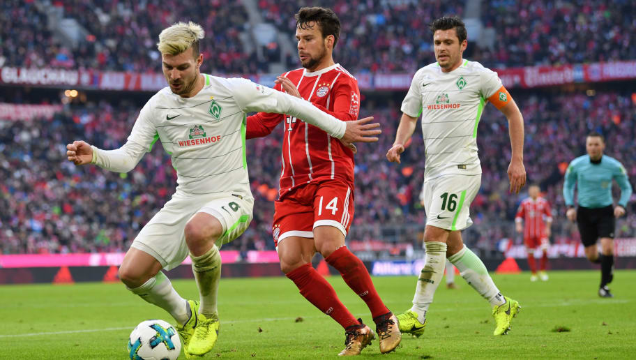 MUNICH, GERMANY - JANUARY 21: Jerome Gondorf of Bremen and Juan Bernat of Bayern Muenchen compete for the ball during the Bundesliga match between FC Bayern Muenchen and SV Werder Bremen at Allianz Arena on January 21, 2018 in Munich, Germany. (Photo by Sebastian Widmann/Bongarts/Getty Images)