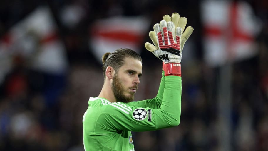 Manchester United's Spanish goalkeeper David de Gea applauds at the end of the UEFA Champions League round of 16 first leg football match Sevilla FC against Manchester United at the Ramon Sanchez Pizjuan stadium in Sevilla on February 21, 2018. / AFP PHOTO / Cristina Quicler        (Photo credit should read CRISTINA QUICLER/AFP/Getty Images)