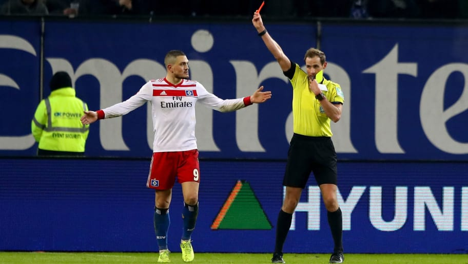 HAMBURG, GERMANY - FEBRUARY 04:  Referee Sascha Stegemann shows the yellow red card to Kyriakos Papadopoulos during the Bundesliga match between Hamburger SV and Hannover 96 at Volksparkstadion on February 4, 2018 in Hamburg, Germany.  (Photo by Martin Rose/Bongarts/Getty Images)