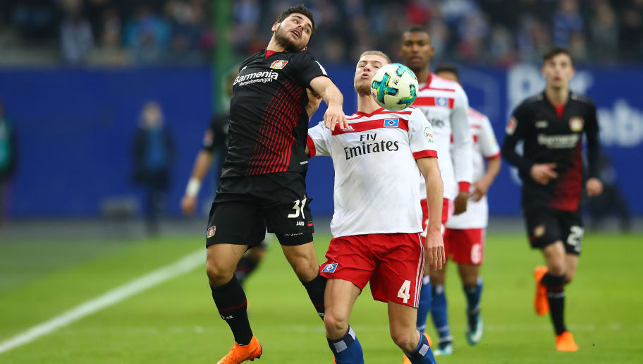 HAMBURG, GERMANY - FEBRUARY 17: Kevin Volland of Bayer Leverkusen (l) fights for the ball with Rick van Drongelen of Hamburg during the Bundesliga match between Hamburger SV and Bayer 04 Leverkusen at Volksparkstadion on February 17, 2018 in Hamburg, Germany. (Photo by Martin Rose/Bongarts/Getty Images)