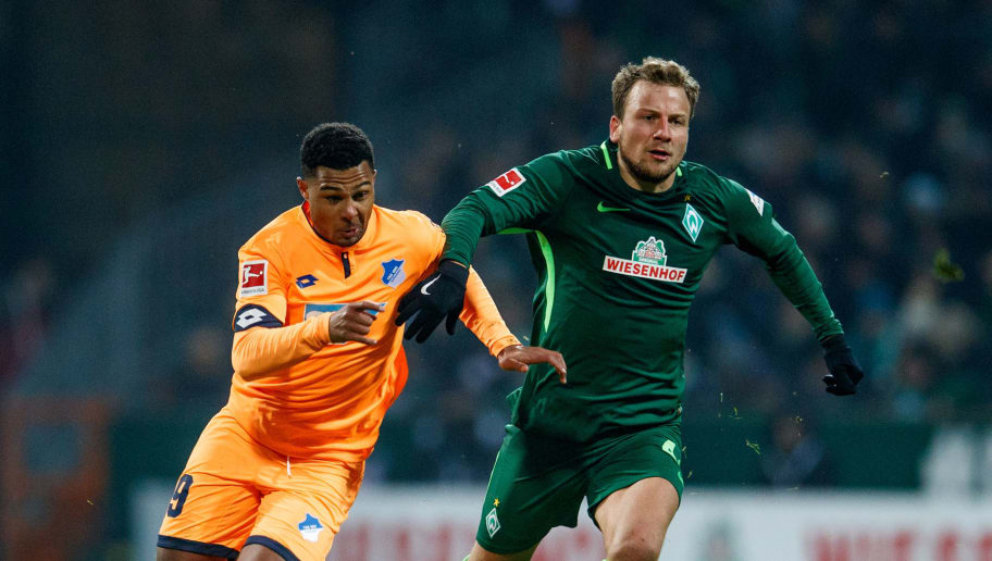BREMEN, GERMANY - JANUARY 13:  Serge Gnabry of Hoffenheim is challenged by Philipp Bargfrede of Bremen during the Bundesliga match between SV Werder Bremen and TSG 1899 Hoffenheim at Weserstadion on January 13, 2018 in Bremen, Germany.  (Photo by Lars Baron/Bongarts/Getty Images)