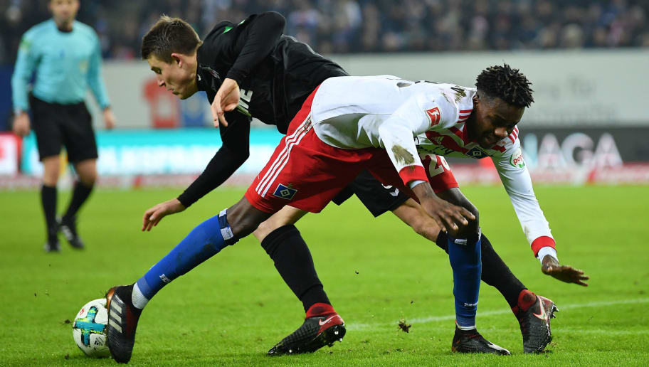 HAMBURG, GERMANY - JANUARY 20:  Gideon Jung of Hamburg is challenged by Dominique Heintz of Cologne during the Bundesliga match between Hamburger SV and 1. FC Koeln at Volksparkstadion on January 20, 2018 in Hamburg, Germany.  (Photo by Stuart Franklin/Bongarts/Getty Images)