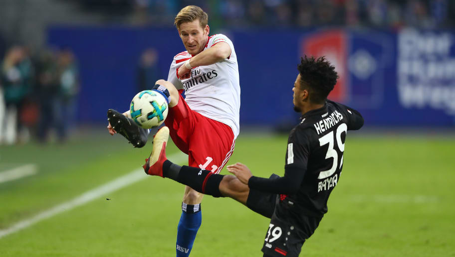 HAMBURG, GERMANY - FEBRUARY 17: Andre Hahn of Hamburg (l) fights for the ball with Benjamin Henrichs of Bayer Leverkusen during the Bundesliga match between Hamburger SV and Bayer 04 Leverkusen at Volksparkstadion on February 17, 2018 in Hamburg, Germany. (Photo by Martin Rose/Bongarts/Getty Images)