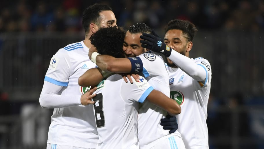 Marseille's French forward Dimitri Payet (2R) celebrates with teammates after scoring a goal during the French Cup round of 16 football match between Bourg-en-Bresse (FBBP) and Marseille (OM) at the Marcel Verchere Stadium in Bourg-en-Bresse, central-eastern France, on February 6, 2018. / AFP PHOTO / ROMAIN LAFABREGUE        (Photo credit should read ROMAIN LAFABREGUE/AFP/Getty Images)