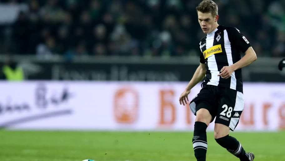 MOENCHENGLADBACH, GERMANY - FEBRUARY 03: Matthias Ginter of Mönchengladbach runs with the ball during the Bundesliga match between Borussia Moenchengladbach and RB Leipzig at Borussia-Park on February 3, 2018 in Moenchengladbach, Germany. (Photo by Christof Koepsel/Bongarts/Getty Images)
