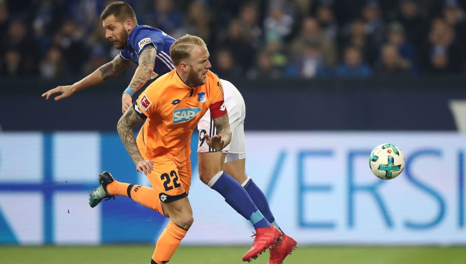 GELSENKIRCHEN, GERMANY - FEBRUARY 17: Kevin Vogt of Hoffenheim (front) fights for the ball with Leon Goretzka of Schalke during the Bundesliga match between FC Schalke 04 and TSG 1899 Hoffenheim at Veltins-Arena on February 17, 2018 in Gelsenkirchen, Germany. (Photo by Christof Koepsel/Bongarts/Getty Images)