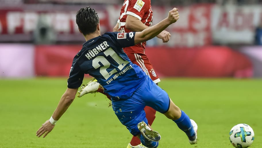 Hoffenheim's German defender Benjamin Huebner fouls Bayern Munich's German midfielder Joshua Kimmich during the German first division Bundesliga football match, Bayern Munich v TSG 1899 Hoffenheim, on January 27, 2018 in Munich, southern Germany. / AFP PHOTO / Gunter SCHIFFMANN / RESTRICTIONS: DURING MATCH TIME: DFL RULES TO LIMIT THE ONLINE USAGE TO 15 PICTURES PER MATCH AND FORBID IMAGE SEQUENCES TO SIMULATE VIDEO. == RESTRICTED TO EDITORIAL USE == FOR FURTHER QUERIES PLEASE CONTACT DFL DIRECTLY AT + 49 69 650050         (Photo credit should read GUNTER SCHIFFMANN/AFP/Getty Images)