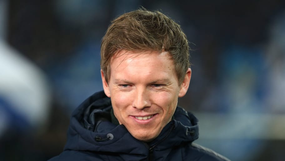 GELSENKIRCHEN, GERMANY - FEBRUARY 17: Coach Julian Nagelsmann of Hoffenheim smiles before the Bundesliga match between FC Schalke 04 and TSG 1899 Hoffenheim at Veltins-Arena on February 17, 2018 in Gelsenkirchen, Germany. (Photo by Christof Koepsel/Bongarts/Getty Images)