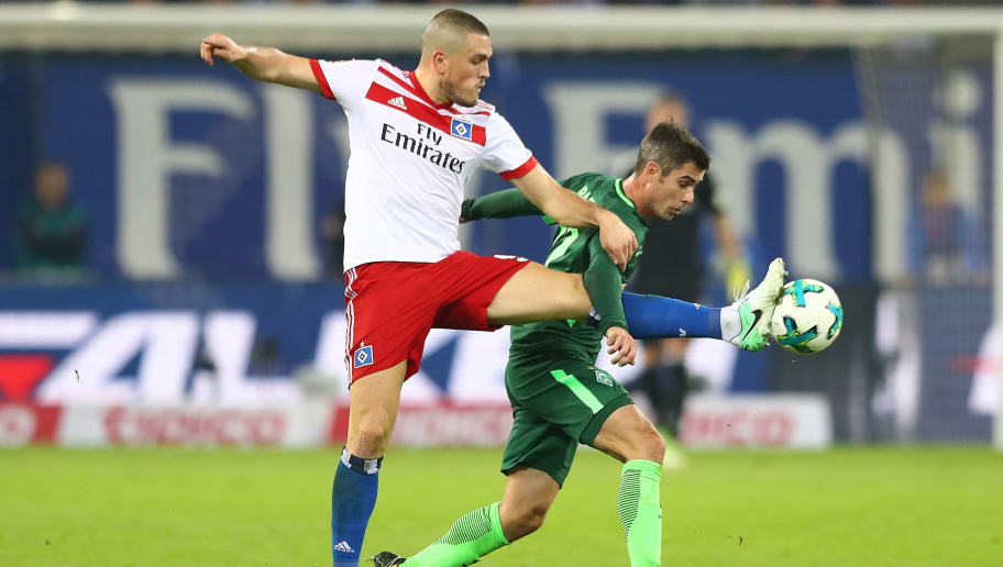HAMBURG, GERMANY - SEPTEMBER 30: Kyriakos Papadopoulos of Hamburg (l) fights for the ball with Fin Bartels of Bremen during the Bundesliga match between Hamburger SV and SV Werder Bremen at Volksparkstadion on September 30, 2017 in Hamburg, Germany. (Photo by Martin Rose/Bongarts/Getty Images)