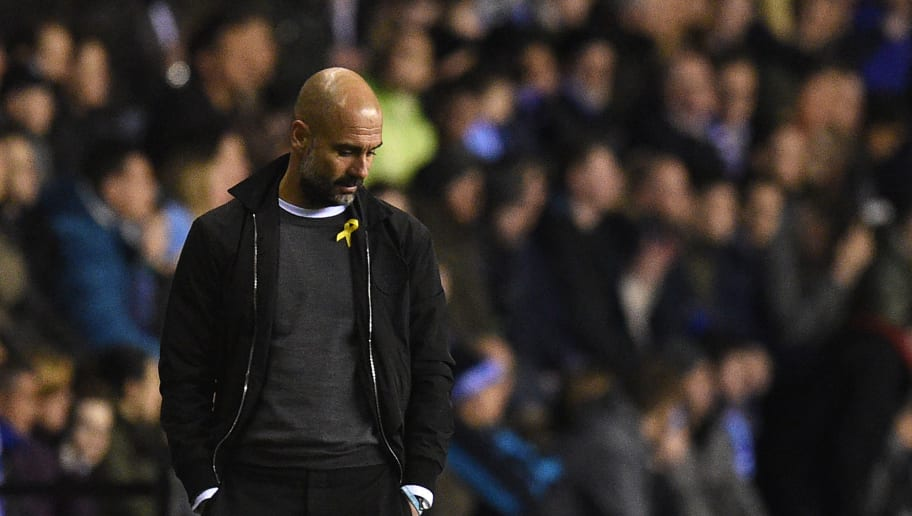 Manchester City's Spanish manager Pep Guardiola reacts during the English FA Cup fifth round football match between Wigan Athletic and Manchester City at the DW Stadium in Wigan, northwest England, on February 19, 2018. / AFP PHOTO / Oli SCARFF / RESTRICTED TO EDITORIAL USE. No use with unauthorized audio, video, data, fixture lists, club/league logos or 'live' services. Online in-match use limited to 75 images, no video emulation. No use in betting, games or single club/league/player publications.  /         (Photo credit should read OLI SCARFF/AFP/Getty Images)