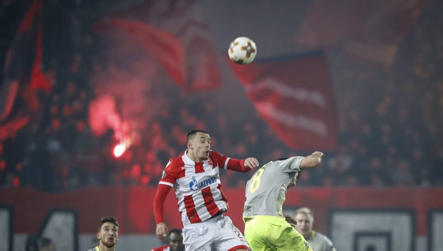 BELGRADE, SERBIA - DECEMBER 07: Milan Rodic (L) of Crvena Zvezda jump for the ball against Milos Jojic (R) of FC Koeln during the UEFA Europa League group H match between Crvena Zvezda and 1. FC Koeln at stadium Rajko Mitic on December 7, 2017 in Belgrade, Serbia. (Photo by Srdjan Stevanovic/Getty Images)